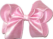 Large Pink Iridescent Dupioni Silk Bow. Ribbon is starched to help keep the bow's shape.