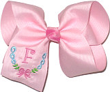 Downsized Large Pink Initial with Bow Monogram on Pink. Alligator Clip.